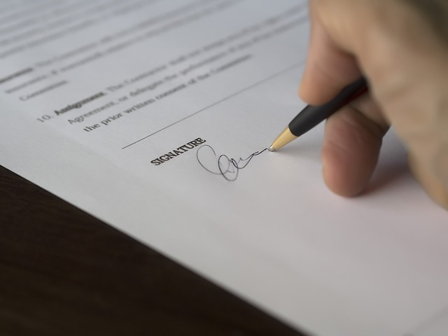 A Brentwood Homebuyer Signing the Real Estate Contract